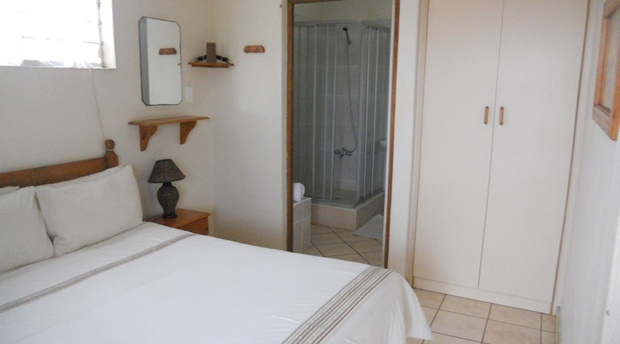 Bedroom with en suite bathroom with shower.
